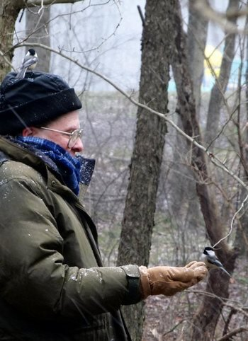 Ray Winstead with two Chickadees at Blue Spruce Park near Indiana, Pennsylvania December 26, 2012
